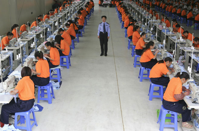 Inmates sew at a compulsory drug rehabilitation centre in Kunming